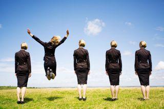 Business women one jump